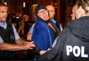 Richard Bain led away by Montreal police