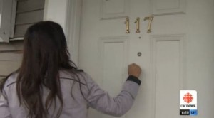 CBC reporter knocking on door