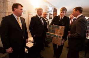 Intern carries boxes past PM