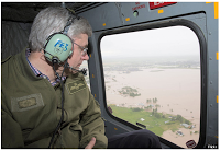 Stephen Harper in helicopter overlooking floods