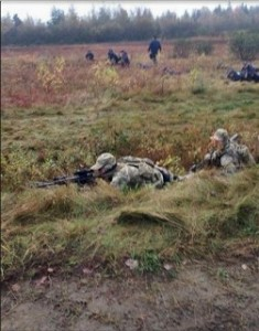 RCMP response team crouched in field