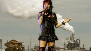 Karaoke singer against oil sands backdrop