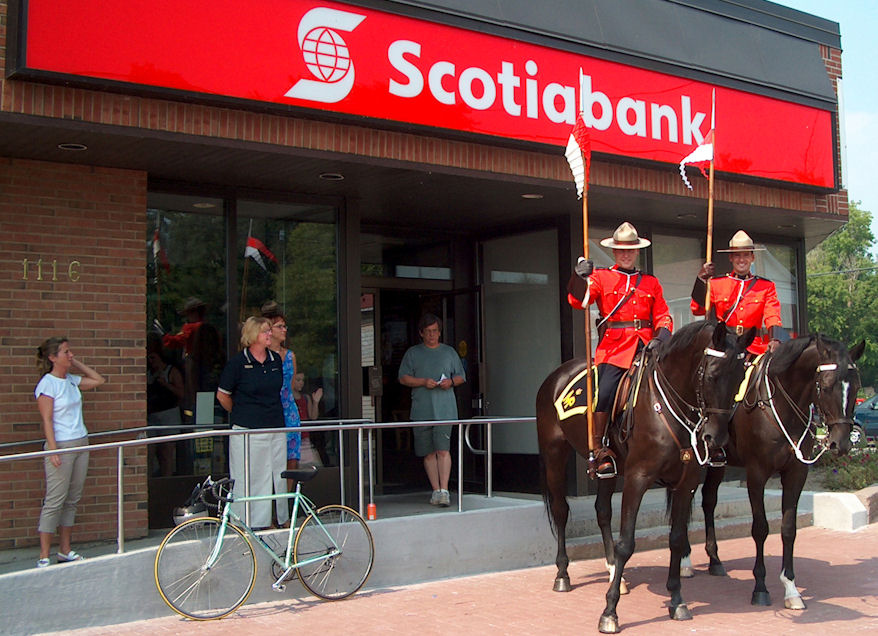 Mounties in front of Scotiabank branch