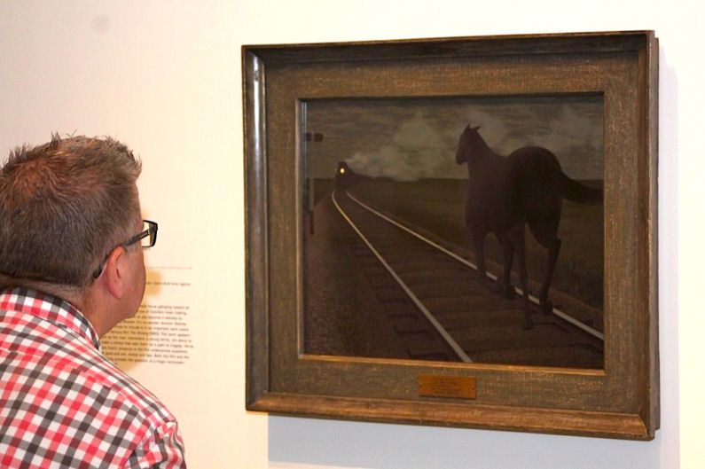 Mickleburgh viewing Colville painting