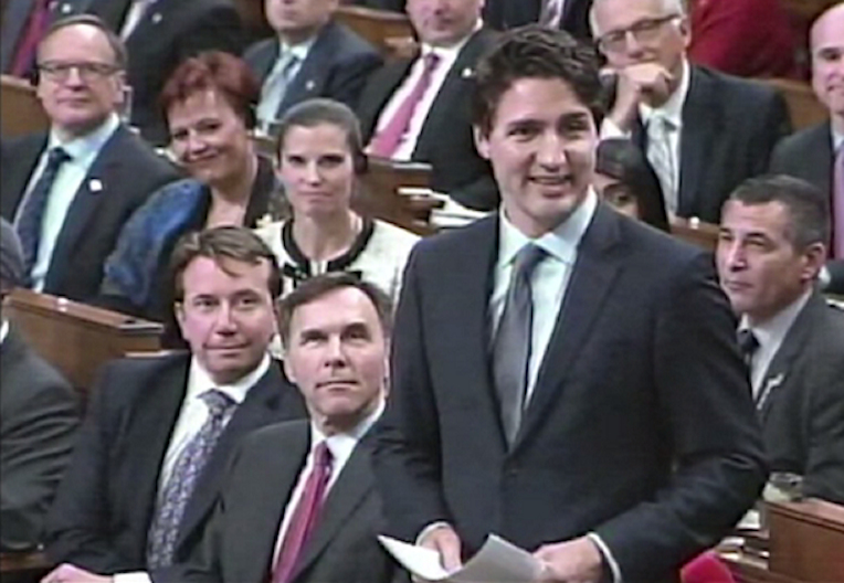 Trudeau in parliament, smiling