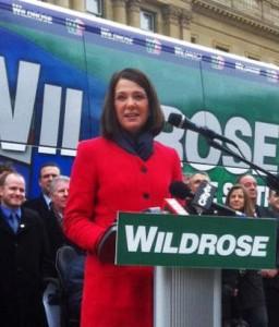 Danielle Smith behind Wildrose podium