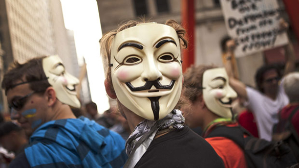 "Image: people wearing ""Anonymous"" masks"