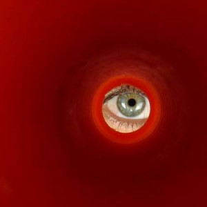 Image: Eye peeking through hole