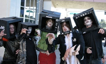 Image: People made up as zombies with TVs on their heads