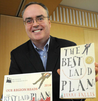 "Image: Terry Fallis with his book, ""The Best Laid Plans"""