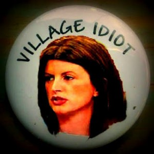 "Rona Ambrose button, reads ""Village Idiot"""