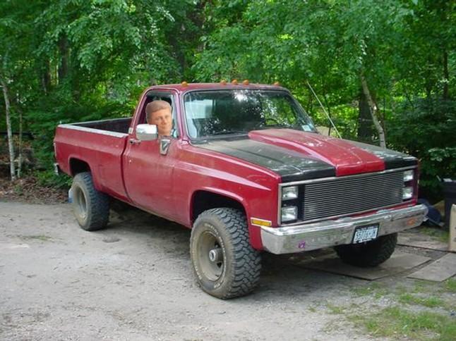 Harper in pickup truck