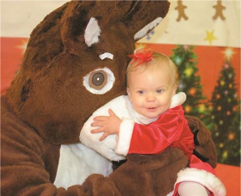 baby hugging Rudolph