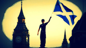 Young man raises Scottish flag