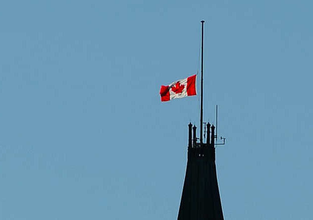 Canadian flag at half mast atop Parliament building