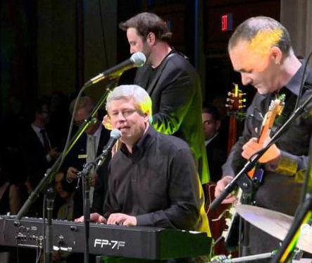 Stephen Harper at keyboard, singing