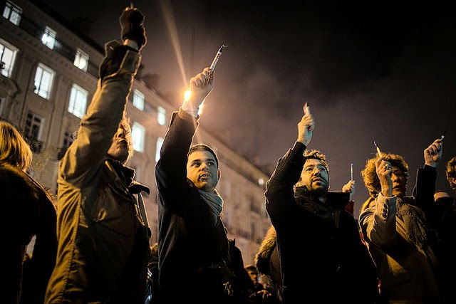 Pens held aloft at Charlie Hebdo rally